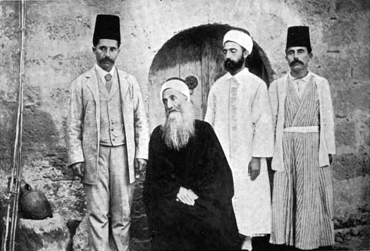 Mīrzā Yaḥyā Nūrī (known as Ṣobḥ-e Azal, 1831–1912), with three of his sons. [1]